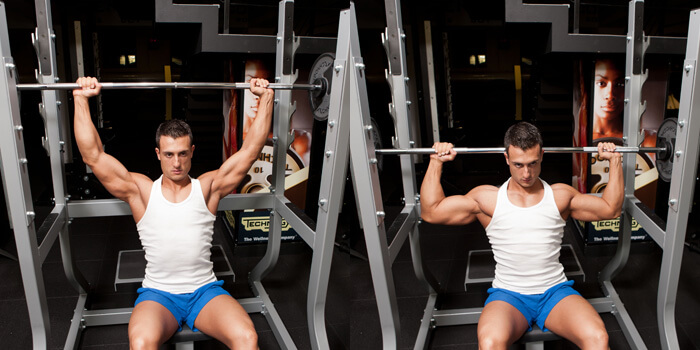seated behind the neck press